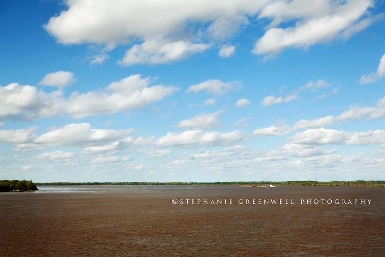 mississippi river spring day clouds blue sky southeast missouri photographer stephanie greenwell