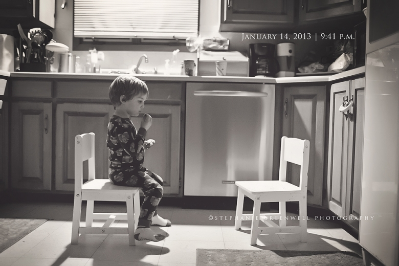little boy eating cookies and milk sitting in kitchen stephanie greenwell photography