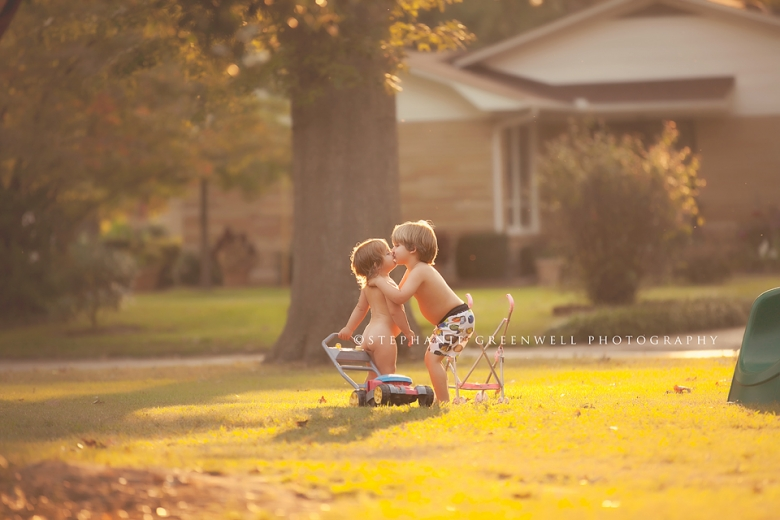 cooper harper kissing siblings sunlight lawn mower stroller stephanie greenwell photography