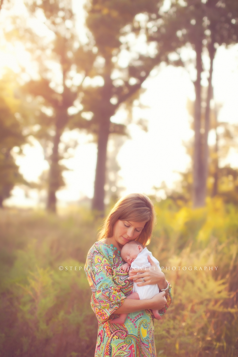 newborn in a field forest mom holding baby vintage southeast missouri photographer stephanie greenwell