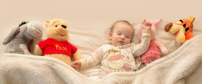 sleeping baby stuffed animals winnie the pooh piglet eeyore tigger bed pajamas stephanie greenwell photography southeast missouri