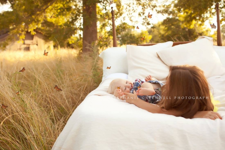 whimsical butterflies children in field on bed playing southeast missouri photographer stephanie greenwell